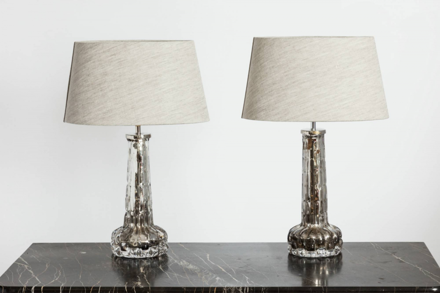 Pair of Silvered Orrefors Lamps